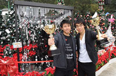 Photo 3 are Jacky Cheung Hoi Fo (right) and Buzz Yip Cheuk Yin, both students from the Department of Architecture of the University of Hong Kong, with their winning tree design.